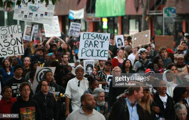 Protestors march during a demonstration for slain 22yearold Oscar Grant III January 14 2009 in Oakland California Twelve days after the fatal...