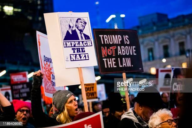 Protestors march during a demonstration in part of a national impeachment rally at the Federal Building in San Francisco California on December 17...