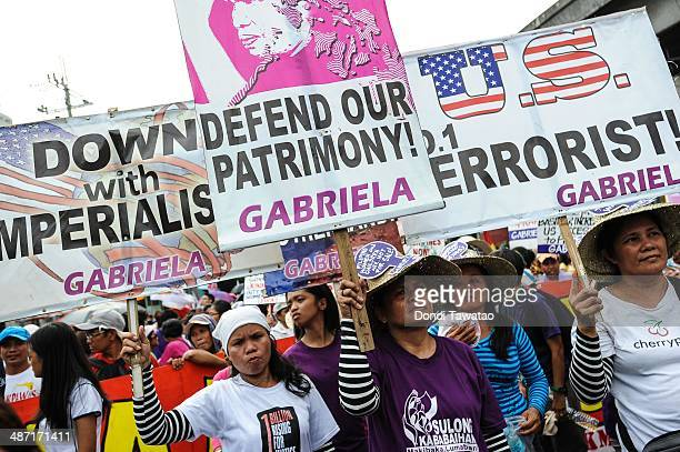 Protestors march during a rally to protest against US president Barack Obama's State visit on April 28 2014 in Manila Philippines The protestors are...