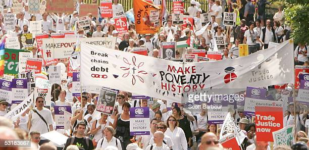 Protestors march during the Make Poverty History protest march on July 2 Edinburgh Scotland Scotland's capital city hosted thousands of protesters...