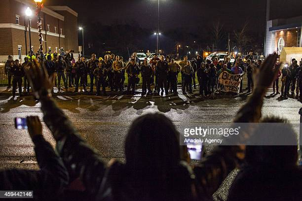 Protestors march in front of the Ferguson Police Department in Ferguson on November 23 2014 The US awaits a grand jurys decision on whether to bring...