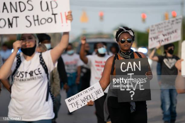 Protestors march in the street after a news conference addressing police video footage of the shooting death of Andrew Brown Jr. On May 11, 2021 in...
