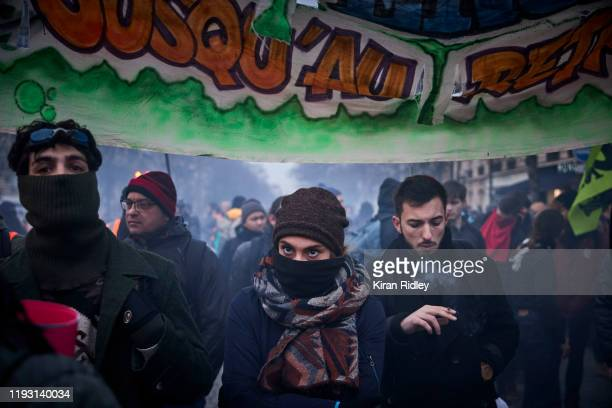 Protestors march near Place denfert Rochereau in Paris as thousands take to the streets to protest against pension reform on the sixth day of...