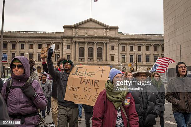 Protestors march on E 6th St in front of City Hall on December 29 2015 in Cleveland Ohio Demonstrators took to the street the day after a grand jury...
