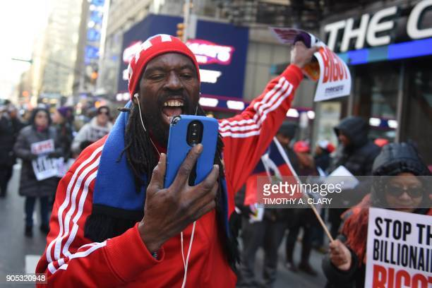 Protestors march on Martin Luther King Jr Day during a demonstration in Times Square called Rally Against Racism Stand Up for Haiti and Africa in New...