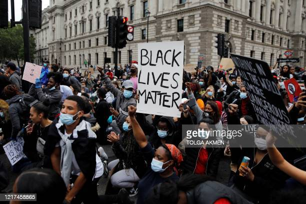 Protestors march on Parliament square during antiracism demonstration in London on June 3 after George Floyd an unarmed black man died after a police...
