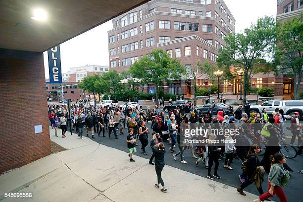 Protestors march past the Portland police department as they remember Alton Sterling and Philando Castile two black men shot and killed by police in...
