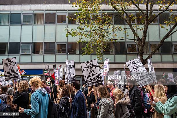 Protestors march through Bloomsbury during a protest against education cuts and tuition fees on November 4 2015 in London England University students...