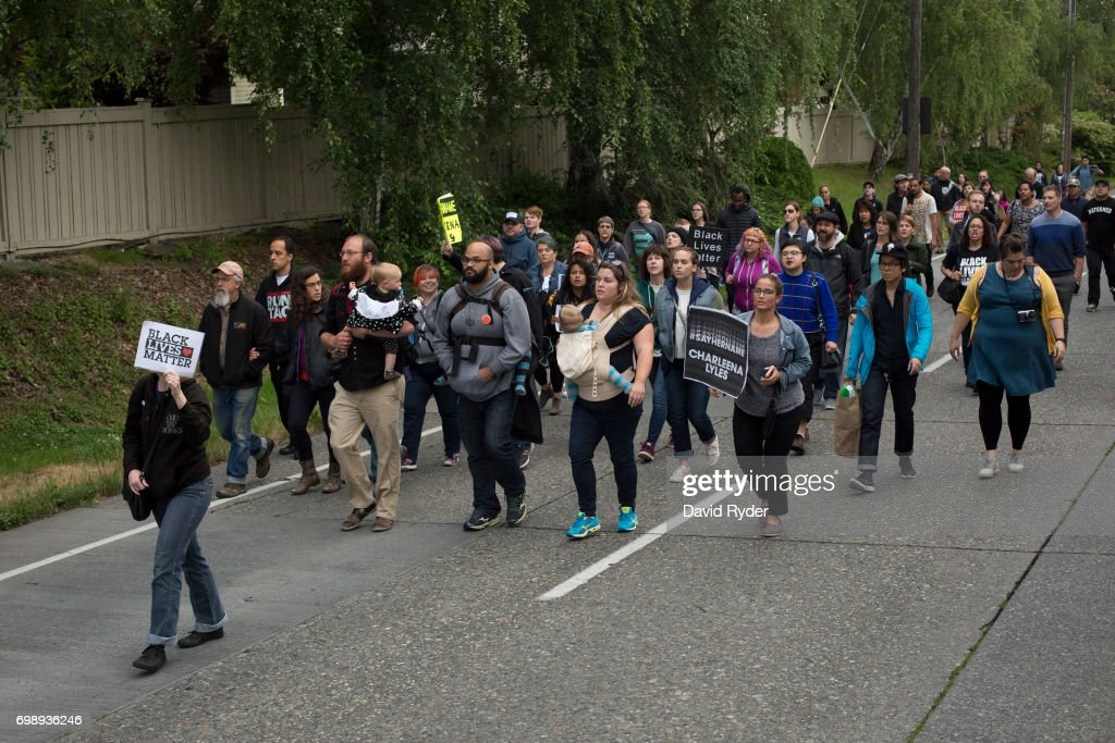 Protestors march through north Seattle after a rally in honor of Charleena Lyles on June 20, 2017 in Seattle, Washington. Officers from the Seattle Police Department shot and killed Lyles, a pregnant mother of four, on June 18.