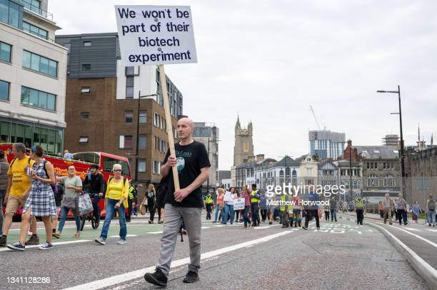 Protestors march through the city centre during a protest against vaccine passports on September 18, 2021 in Cardiff, Wales. First Minister of Wales...