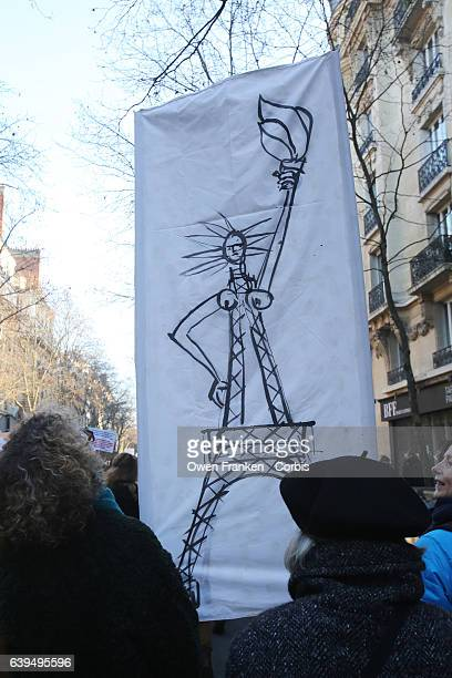 Protestors march through the streets as over 2000 people protest during the Women's march on January 21 2017 in Paris France The Women's March...