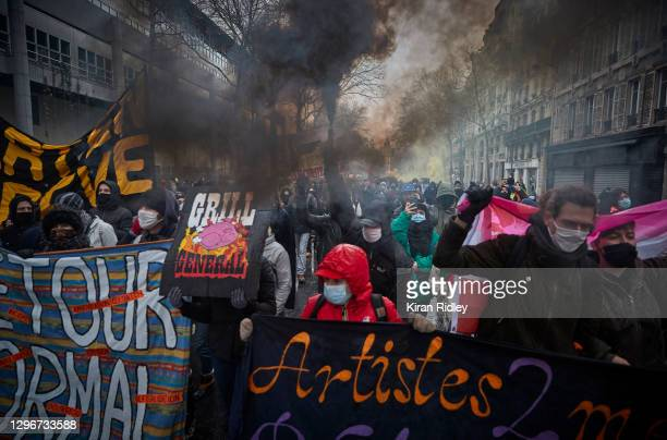 Protestors march through the streets of Paris demonstrating against the Global Security Bill on January 16, 2021 in Paris, France. At the call of...