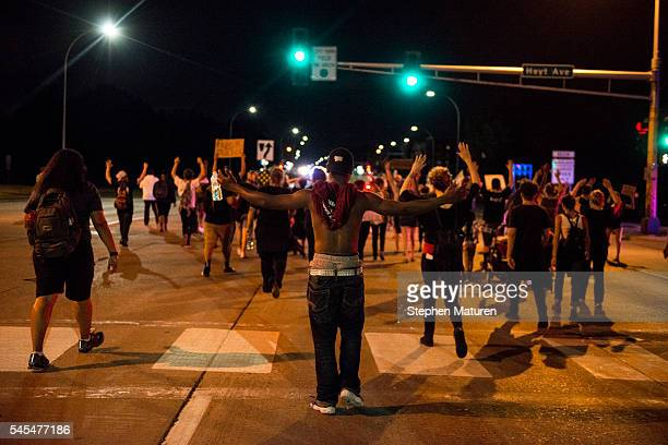 Protestors march through the streets of St Paul Minnesota after the death of Philando Castile on July 7 2016 Castile was shot and killed by a police...