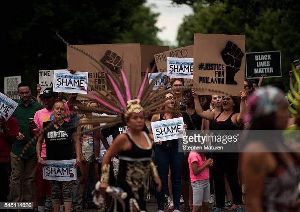 Protestors march through the streets of St Paul Minnesota to J J Hill Montessori School for a memorial for Philando Castile on July 7 2016 Castile...