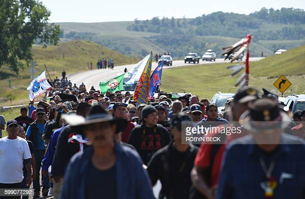 Protestors march to a construction site for the Dakota Access Pipeline to express their opposition to the pipeline at an encampment where hundreds of...