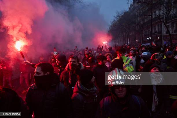 Protestors march towards French Riot Police amidst violent clashes between police and protestors during a rally near Place de Republique in support...