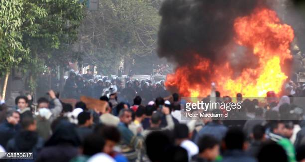 Protestors mass in front of a police line on January 29 2011 in Cairo Egypt Tens of thousands of demonstrators have taken to the streets across Egypt...