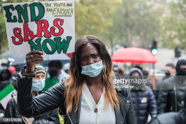 Protestors match down Whitehall as up to one thousand British Nigerians protest against corruptions and killings in Lagos on October 21, 2020 in...