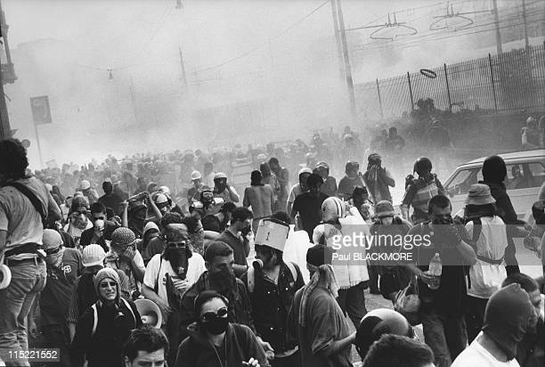 Protestors move back during protests against the 27th Group of Eight Summit in July 2001 in Genoa Italy Hundreds of thousands of protesters gathered...