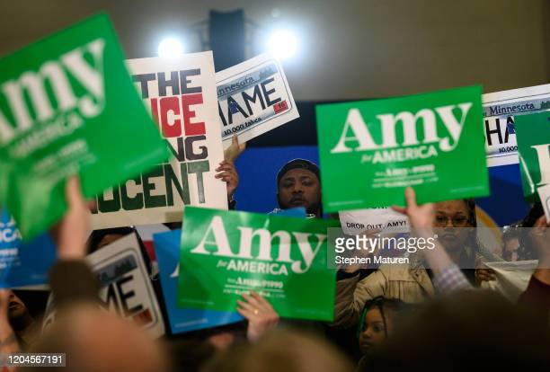 Protestors on stage during a rally for Democratic presidential candidate Sen Amy Klobuchar on March 1 2020 in St Louis Park Minnesota The protesters...