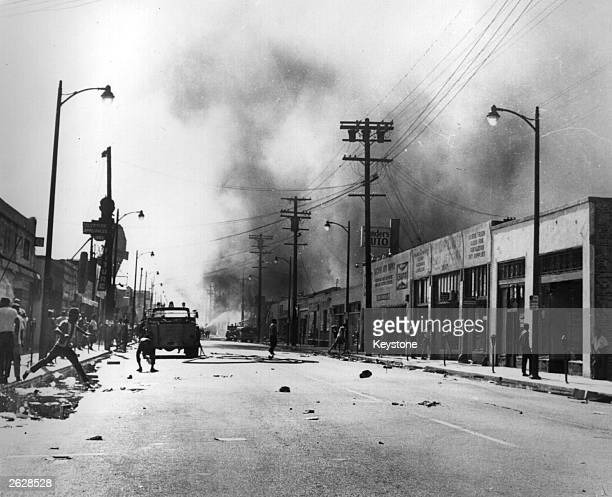 Protestors on the burned out streets of the Watts District after the race riots in Los Angeles