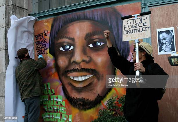 Protestors paint a mural of slain 22yearold Oscar Grant III January 14 2009 in Oakland California Twelve days after the fatal shooting of Oscar Grant...