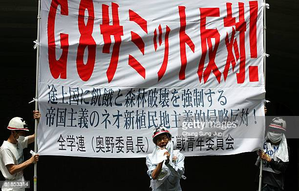 Protestors participate in a rally against G8 summit at the Odori Park on July 8 2008 in Saporro Japan The G8 Hokkaido Toyako Summit takes place at...