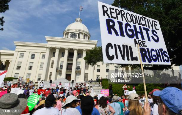 Protestors participate in a rally against one of the nation's most restrictive bans on abortions on May 19, 2019 in Montgomery, Alabama....