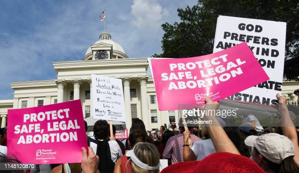 Protestors participate in a rally against one of the nation's most restrictive bans on abortions on May 19 2019 in Montgomery Alabama Demonstrators...