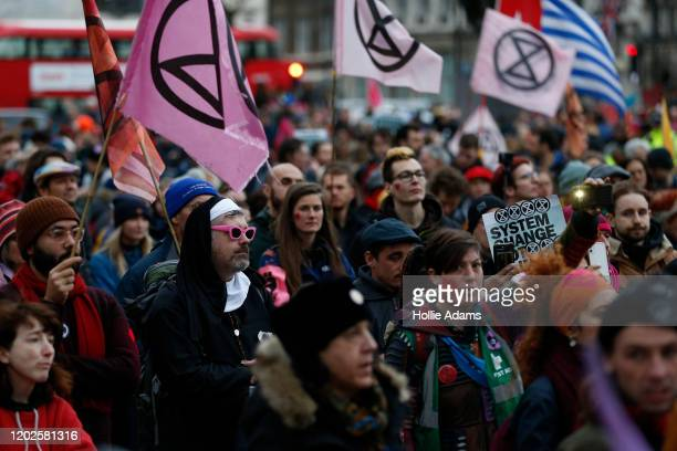 Protestors participate in Extinction Rebellion's Enough Is Enough march in Parliament Square on February 22 2020 in London England