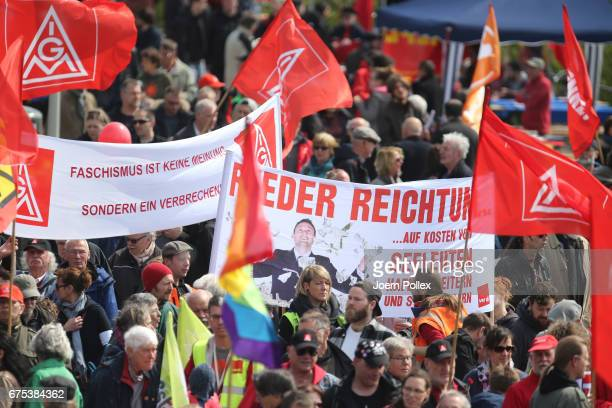 Protestors participate in the German Confederation of Trade Unions march on May Day on May 1 2017 in Hamburg Germany Tens of thousands of people...