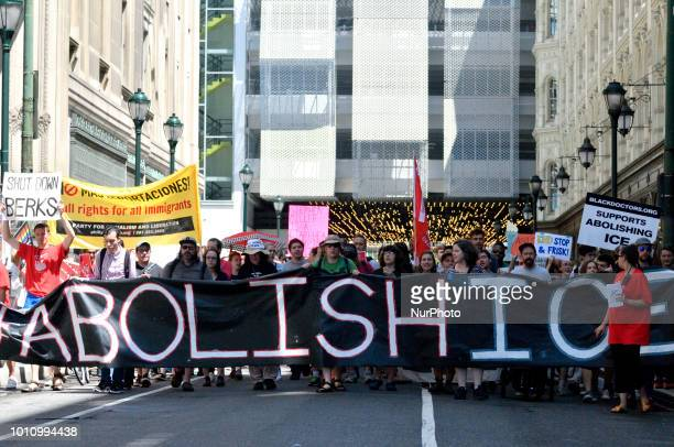 Protestors participating in an Abolish ICE protest march through Center City to demand the halt of deportations and an end to family detentions...
