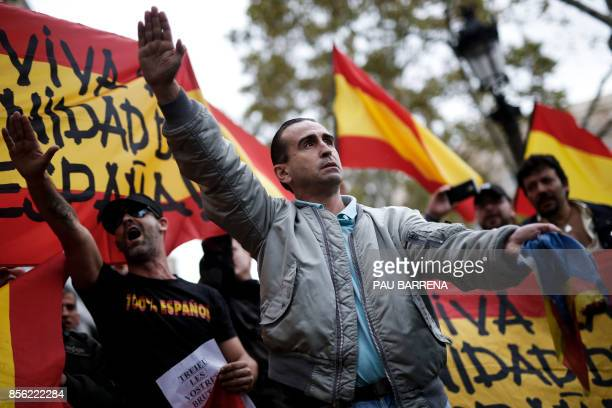 TOPSHOT Protestors perform a fascist salute during a demonstration called by farright groups against a referendum on independence for Catalonia on...