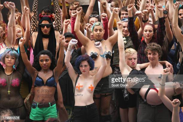 Protestors pose for a group photo following a march through downtown during Slutwalk on September 7 2013 in Chicago Illinois Slutwalk which was...