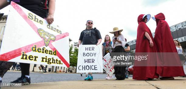 Protestors prepare to participate in a rally against one of the nation's most restrictive bans on abortions on May 19 2019 in Montgomery Alabama...