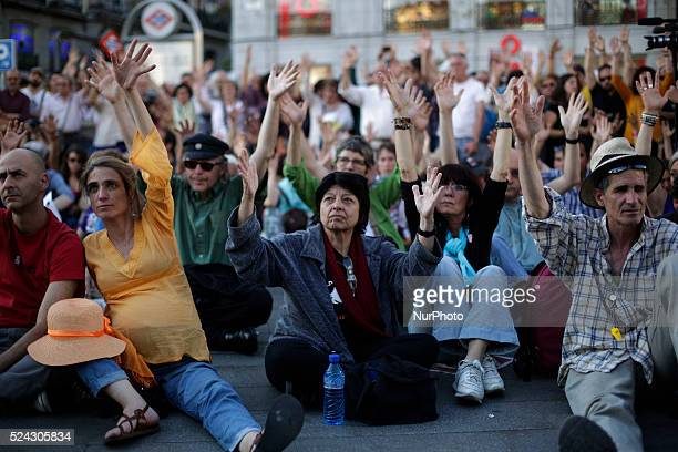Protestors raise their hands as they attend an assembly at la puerta del sol after a protest against austerity in Madrid Spain May 17th 2014...