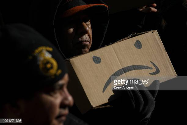 Protestors rally against Amazon and the company's plans to move their second headquarters to the Long Island City neighborhood of Queens at New York...
