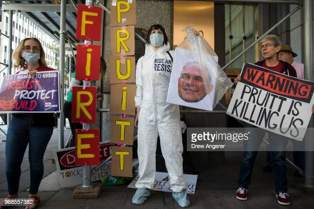 Protestors rally against Environmental Protection Agency Administrator Scott Pruitt outside the federal office building that houses the New York City...