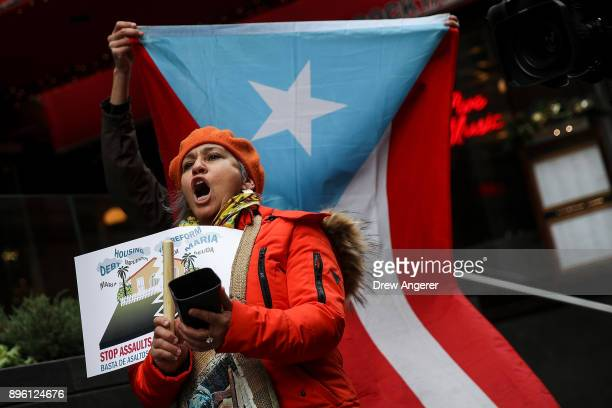 Protestors rally against foreclosures on Puerto Rican families affected by Hurricane Maria outside the offices of TPG Capital December 20 2017 in New...