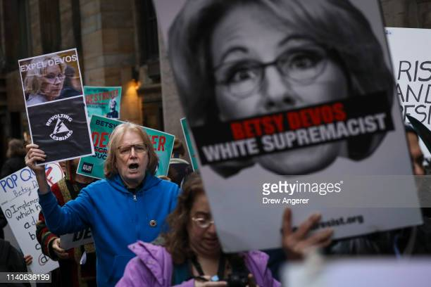 Protestors rally against US Secretary of Education Betsy DeVos outside of a banquet hall in Midtown Manhattan May 1 2019 in New York City DeVos was...