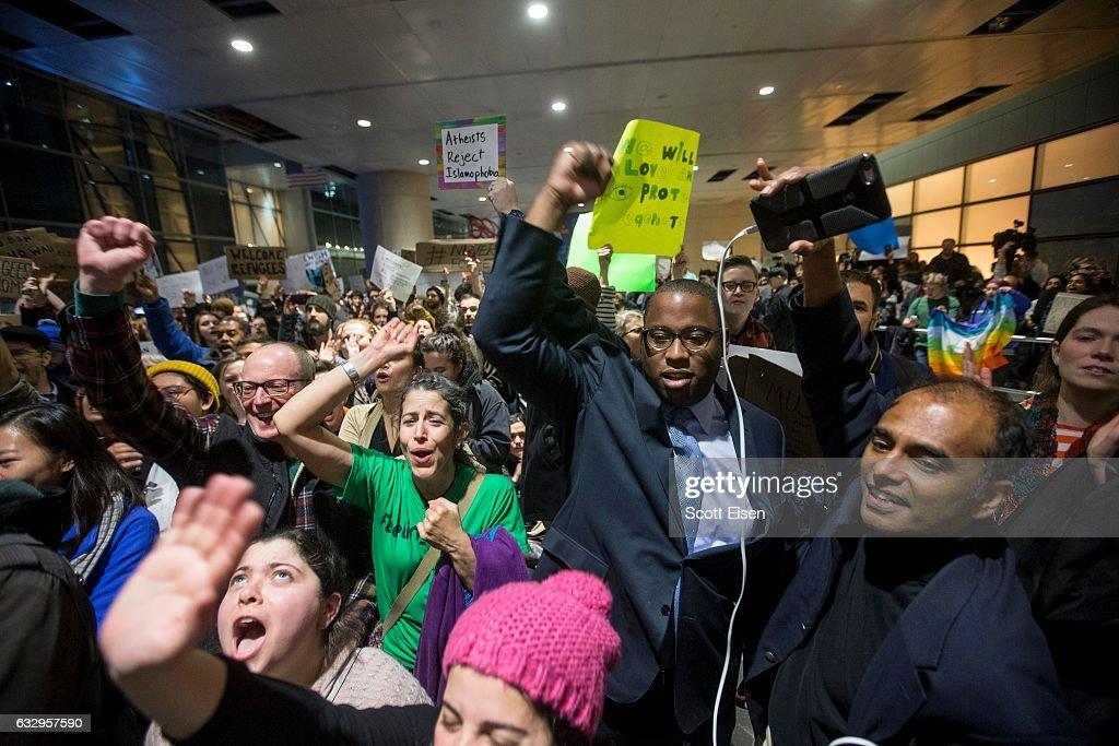 Protestors Rally At Boston's Logan Airport Against Muslim Immigration Ban : News Photo