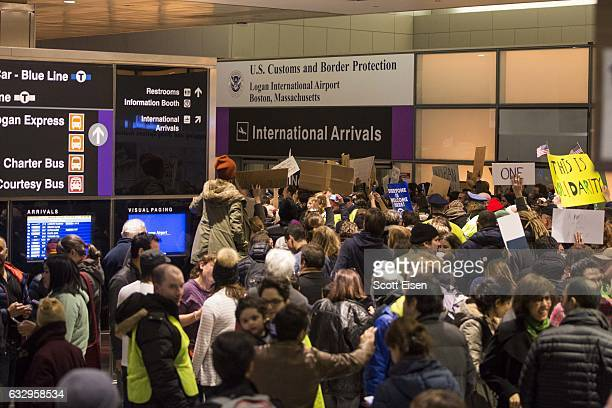 Protestors rally at a demonstration against the new ban on immigration issued by President Donald Trump at Logan International Airport on January 28...