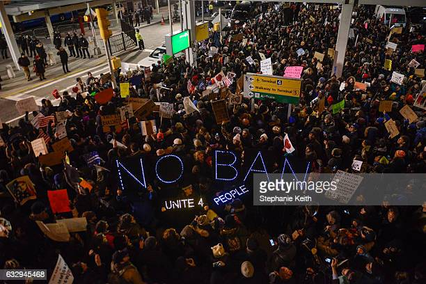 Protestors rally during a demonstration against the Muslim immigration ban at John F Kennedy International Airport on January 28 2017 in New York...