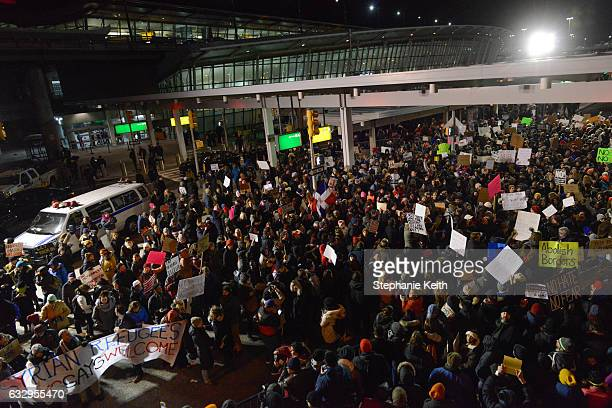 Protestors rally during a demonstration against the new immigration ban issued by President Donald Trump at John F Kennedy International Airport on...