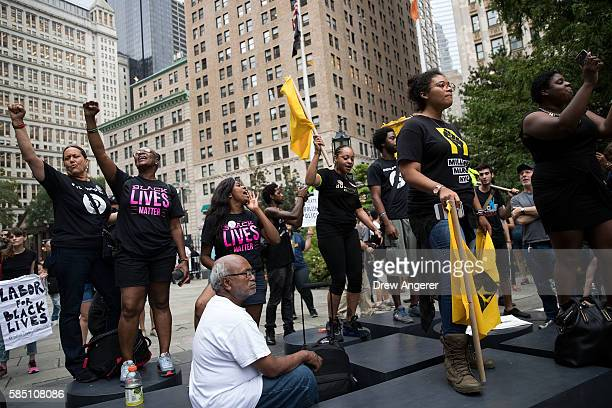 Protestors rally during a protest against police brutality at City Hall Park August 1 2016 in New York City The protest was organized by Millions...