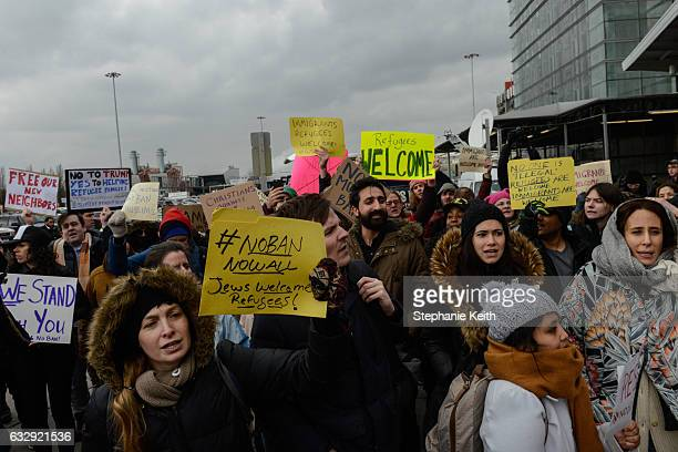 Protestors rally during a protest against the Muslim immigration ban at John F Kennedy International Airport on January 28 2017 in New York City...