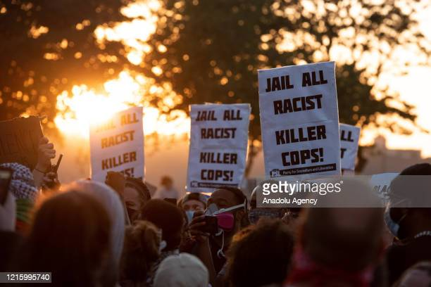 Protestors rally outside the Minneapolis 3rd police precinct on Thursday May 28 during the third day of protests over the death of George Floyd in...