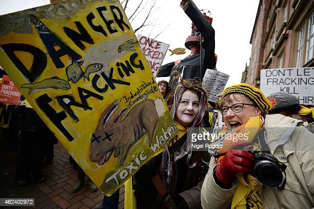 Protestors react outside a council meeting to decide on two sites in Lancashire for fracking plants at Lancashire County Hall on January 28, 2015 in...