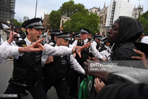 Protestors remonstrate with Police officers in Parliament Square during an antiracism demonstration in London on June 3 after George Floyd an unarmed...