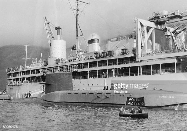 CND protestors row a small craft alongside the 6700 ton US Polaris submarine 'USS Patrick Henry' in Scotland's Holy Loch 8th March 1961 The 'Patrick...